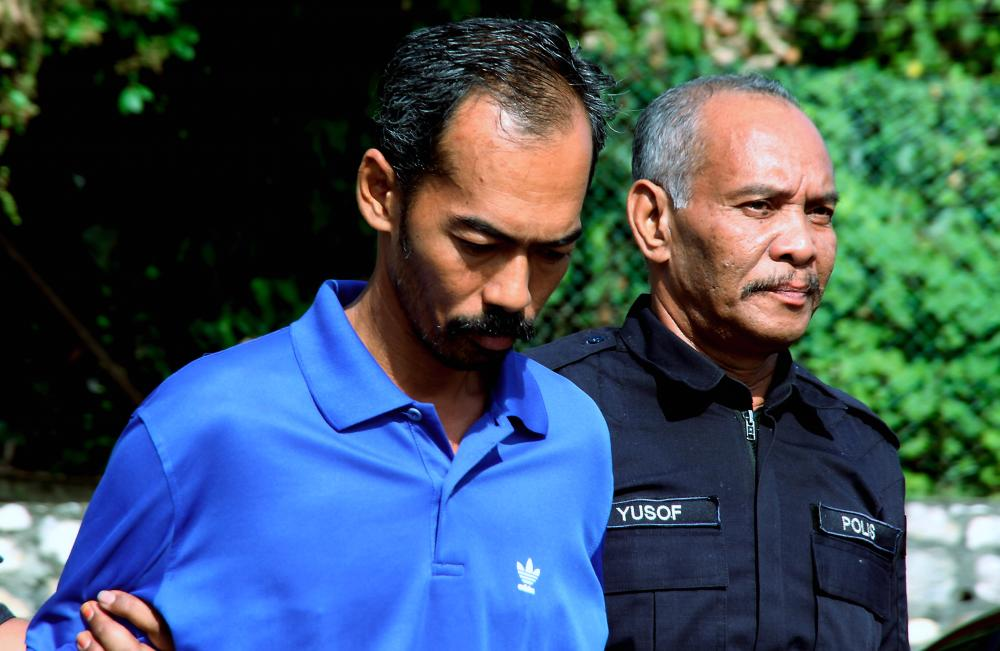 Plantation worker Abdul Rahman Abu Bakar, 43, was charged in the Parit magistrate's court today for the charge of killing a disabled man in a quarry at Felcra Changkat Lada, Kampung Gajah, near here. - Bernama