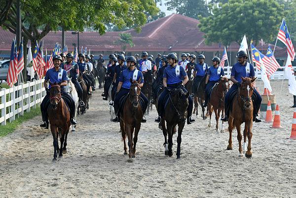 The mounted unit of Putrajaya Corporation's (PPj) enforcement section training for the parade during the National Day celebrations, at Dataran Putrajaya yesterday. — Bernama