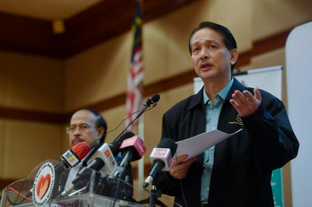 Health director-general Datuk Dr Noor Hisham Abdullah (R) during the daily press conference on Covid-19 at the Ministry of Health today. - Bernama