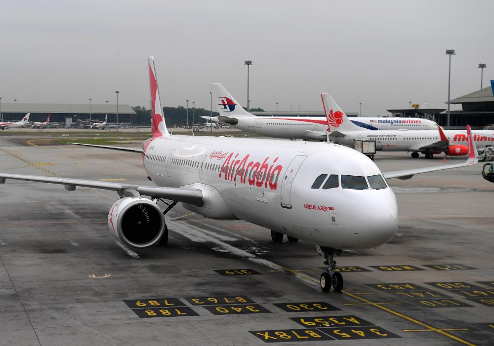 An Air Arabia plane landed safely today during the reception of the first flight in the Sharjah, UAE to Kuala Lumpur route, at the Kuala Lumpur International Airport (KLIA) today. - Bernama