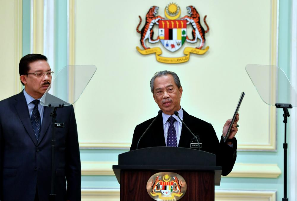 Prime Minister Tan Sri Muhyiddin Yassin announces the Cabinet appointments for his government at the Perdana Putra today. - Bernama