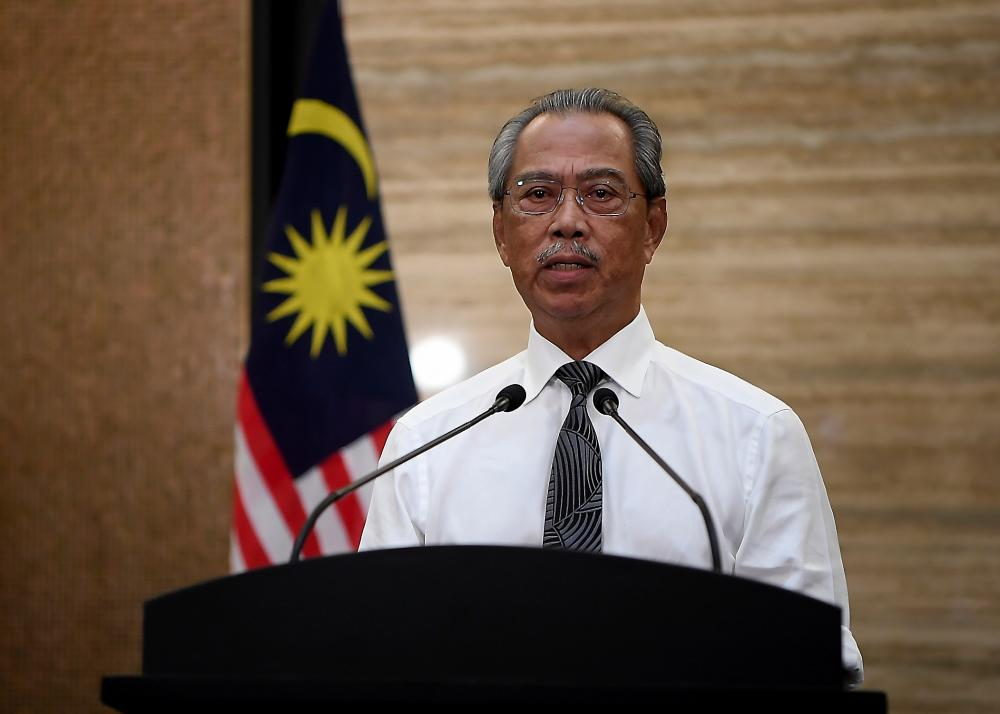 Prime Minister Tan Sri Muhyiddin Yassin delivers his Covid-19 special address that aired live on all television channels and social media platforms tonight. - Bernama