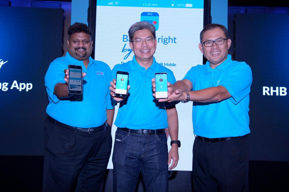 From left: Group COO Rohan Krishnalingam, Khairussaleh, acting head of Group Retail Banking Nazri Othman.