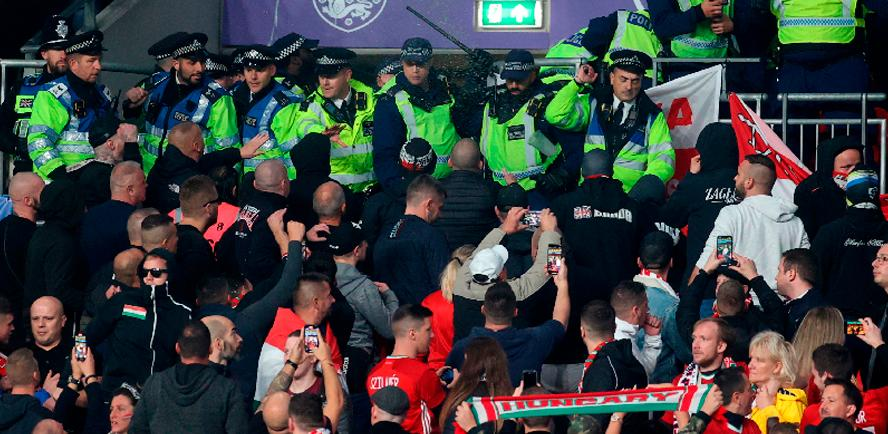 General view as Police clash with Hungary fans during the match between Englanf and Hungary. – REUTERSPIX