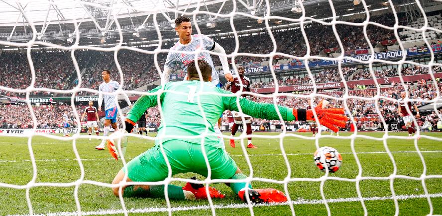Manchester United's Cristiano Ronaldo (back) scores their first goal against West Ham. – REUTERSPIX