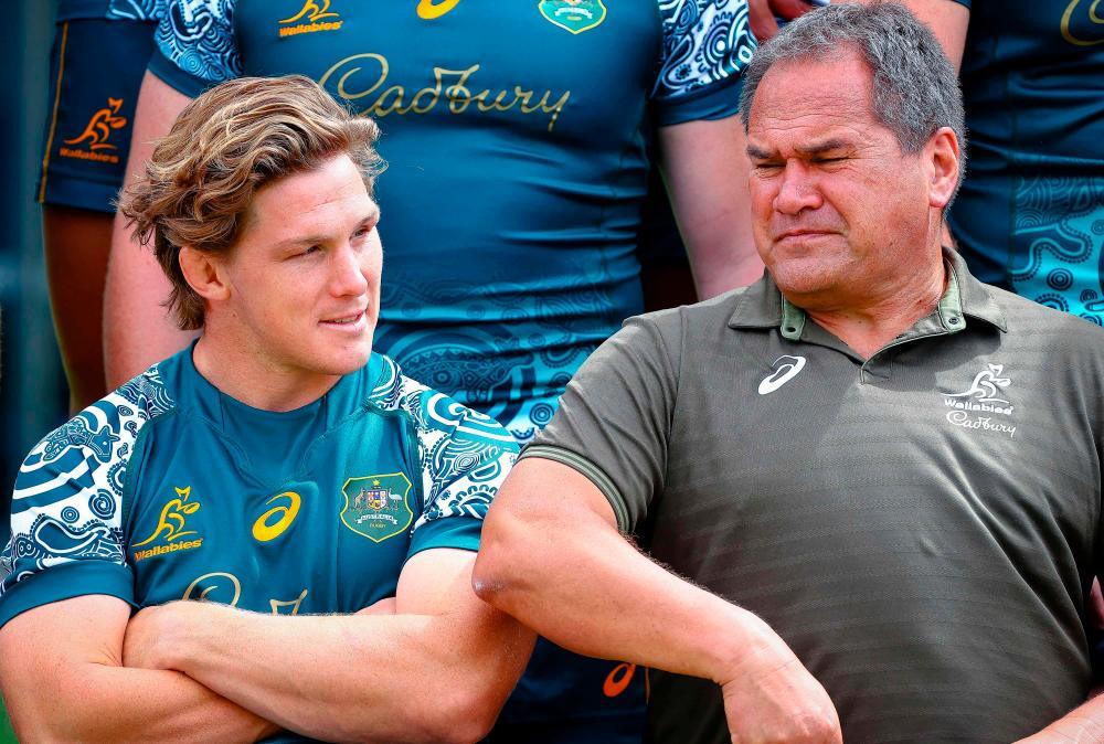 Australia's captain Michael Hooper (L) talks to team's head coach Dave Rennie before the captain's run in Townsville – AFPPIX