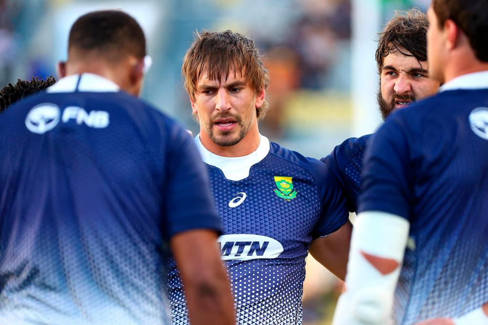 South Africa's Eben Etzebeth (Centre) and teammates huddle before their rugby Championship match against New Zealand in Townsville – AFPPIX