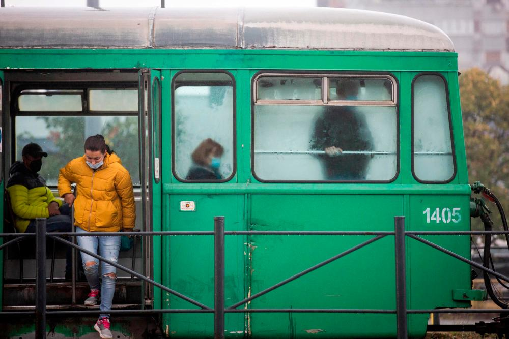 Passengers wearing face masks ride a tram in Belgrade on October 11, 2021, amid the Covid-19 (novel coronavirus) pandemic. AFPpix