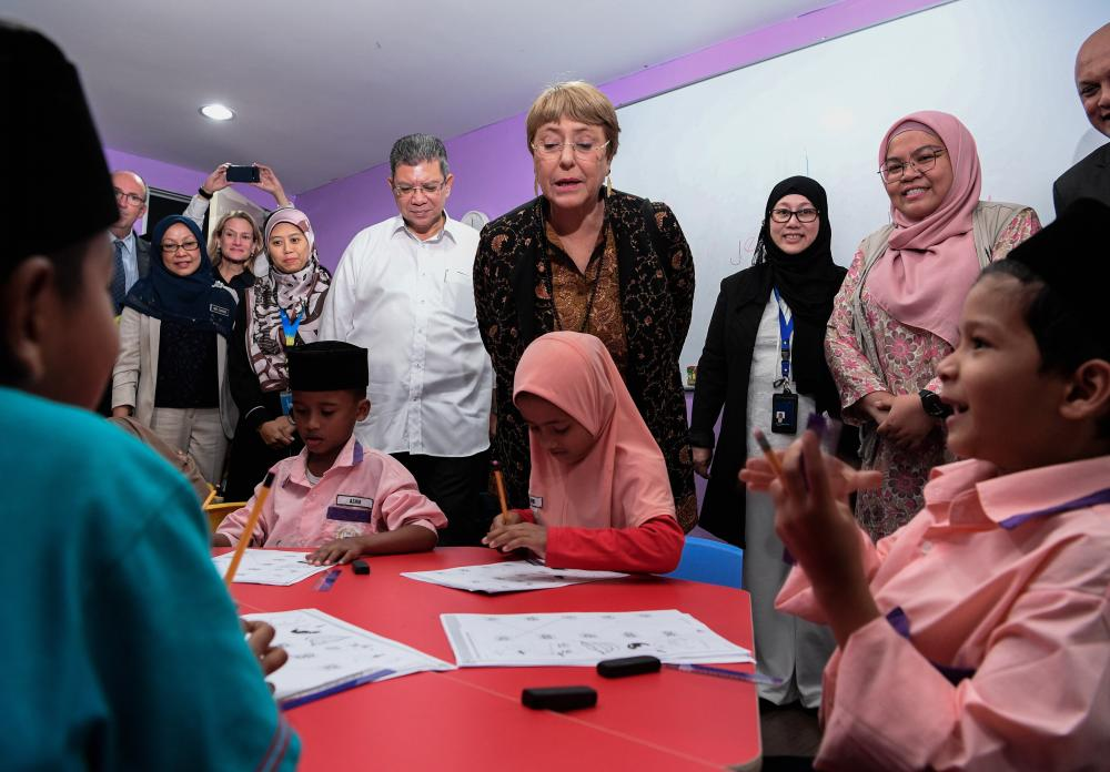 Foreign Affairs Minister Datuk Saifuddin Abdullah (4th from R) joins UN High Commissioner for Human Rights Michelle Bachelet (3rd from R) visiting Rohingya children at the Rohingya Integrated School of Excellence (RISE) today.- Bernama