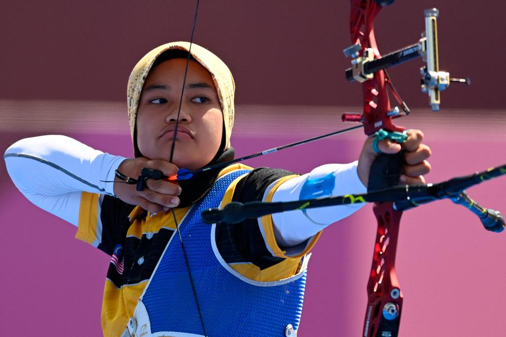 Malaysia's Syaqiera Mashayikh competes in the womens's individual eliminations during the Tokyo 2020 Olympic Games at Yumenoshima Park Archery Field in Tokyo July 27, 2021. — AFP