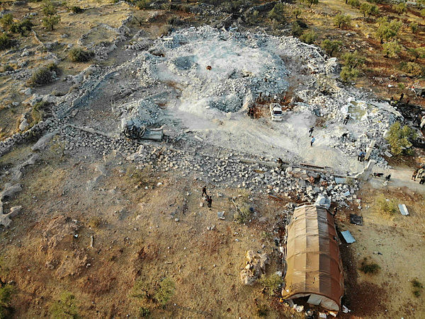 """An aerial view taken on October 27, 2019 shows the site that was hit by helicopter gunfire which reportedly killed nine people near the northwestern Syrian village of Barisha in the Idlib province along the border with Turkey, where """"groups linked to the Islamic State (IS) group"""" were present, according to a Britain-based war monitor with sources inside Syria. — AFP"""