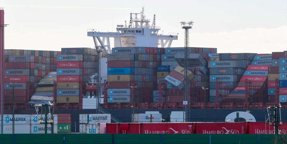 The container carrier MSC Zoe lies in the harbour of Bremerhaven, northern Germany, on Jan 3, 2019. The cargo ship caught on Jan 2, 2019 in rough North Sea weather lost at least 270 containers, including some holding potentially dangerous substances, the Dutch and German coastguards said. — AFP