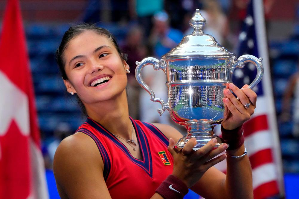 Raducanu celebrates with the trophy after winning the 2021 US Open Tennis tournament women's final match against Fernandez at the USTA Billie Jean King National Tennis Center in New York. – AFPPIX