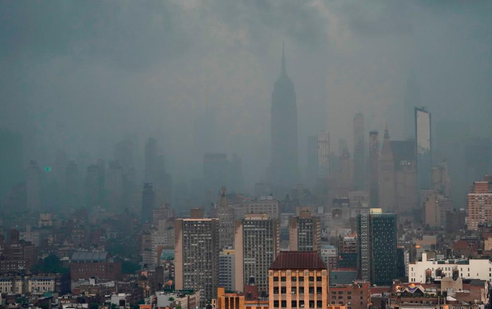 Rain covers the Empire State Building in New York July 8, 2012 as Tropical Storm Elsa moves up the Northeast with heavy rain and flash flood warnings. – AFP