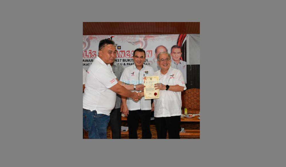 Uggah (right) hands over appointment letter to new longhouse chief Luta Empaga from Manga Bong as Chuat looks on.