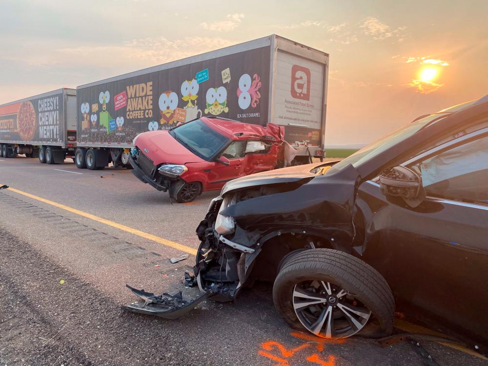 In this photo taken by the Utah Highway Patrol on July 25, 2021, cars and trucks are seen after an accident on Interstae 15 in Millard County, Utah. -AFP