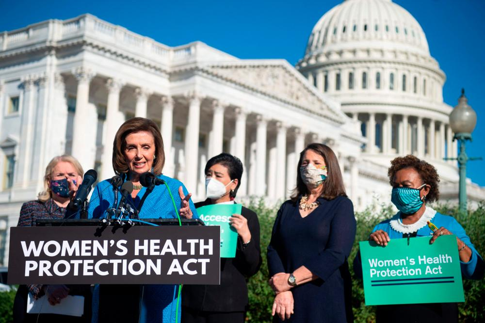 """US Speaker of the House Nancy Pelosi, Democrat of California, joins House Democrats at a news conference on the """"Women's Health Protection Act,"""" on September 24, 2021, outside the US Capitol in Washington DC. AFPpix"""