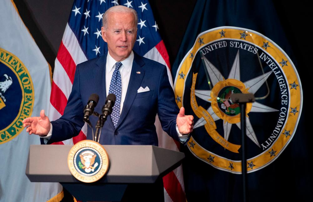 US President Joe Biden addresses the Intelligence Community workforce and its leadership while on a tour at the Office of the Director of National Intelligence in McLean, Virginia, on July 27, 2021. -AFP