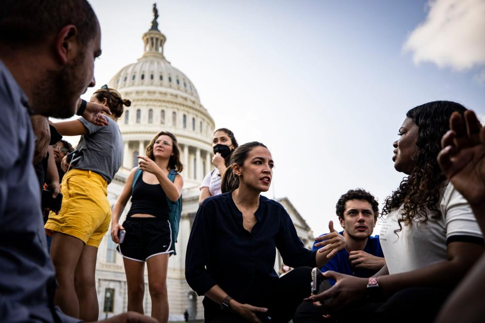 US Representatives Alexandria Ocasio-Cortez (D-NY) (center) and Cori Bush (D-MO) (right) continue their protest for an extension of the eviction moratorium on the steps to the House of Representatives at the U.S. Capitol Building on August 1, 2021 in Washington, DC. -AFP