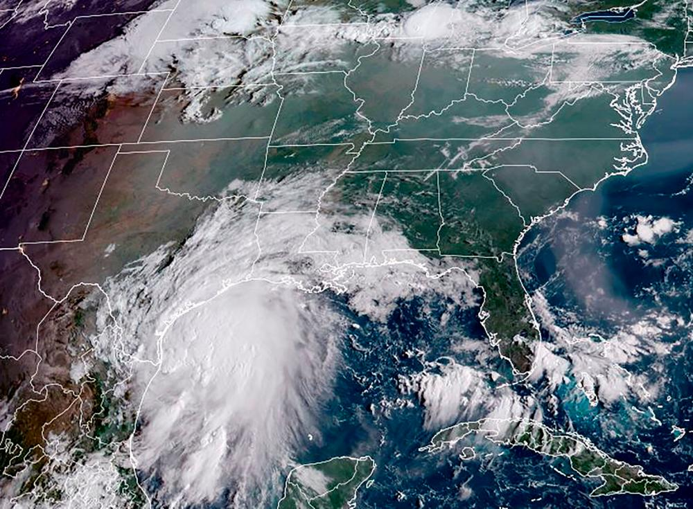 This RAMMB National Oceanic and Atmospheric Administration (NOAA) satellite handout image shows Tropical Storm Nicholas, off the coastline of the US state of Texas at 13H40 UTC on September 13, 2021. AFPpix