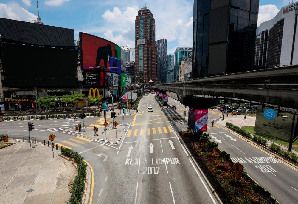 An unusual sight in Kuala Lumpur's epicenter of entertainment-Bukit Bintang-on the first day movement control order was enforced nationwide. SUNPIX BY HAFIZ SOHAIMI