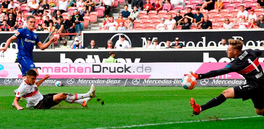 Leverkusen's Florian Wirtz (left) scores the 3-1 past Stuttgart's goalkeeper Florian Muller (right) during the German Bundesliga match. – AFPPIX